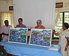 Mr. Unnikrishnan, President, Vazhachal CFR Coordination Sanghan, Mr.N. Rajesh, DFO, Vazhachal Forest Division, Dr.Sejal Worah, Programme Director, WWF-India, and Ms.Vishaish Uppal, WWF-India release the 'Important fish of Vazhachal CFR Areas' poster